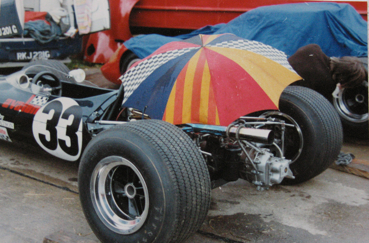 The Chevron B9 sheltering under a brollie!